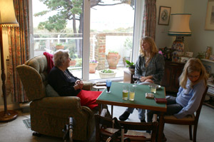 My Grandmother's sitting room with a view to the beach on Hayling Island and the card table where she has polished her bridge playing skills to be feared still along the south coast. My sister Claire in shot with eldest Loviisa
